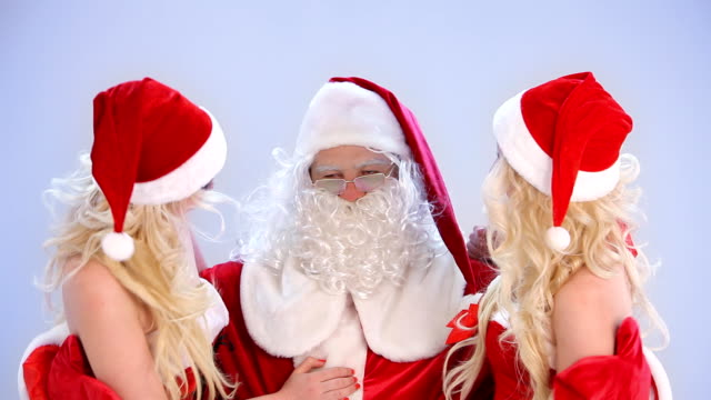 two christmas girls flirting with santa claus - desire stock videos & royalty-free footage