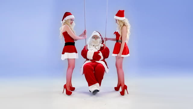 Two Christmas girls swings Santa Claus