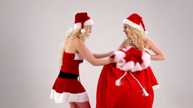 two christmas woman struggle for gift sack - the competition stock videos and b-roll footage