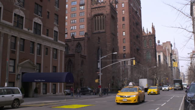 two churches along 5th avenue in greenwich village in manhattan - greenwich village stock videos & royalty-free footage