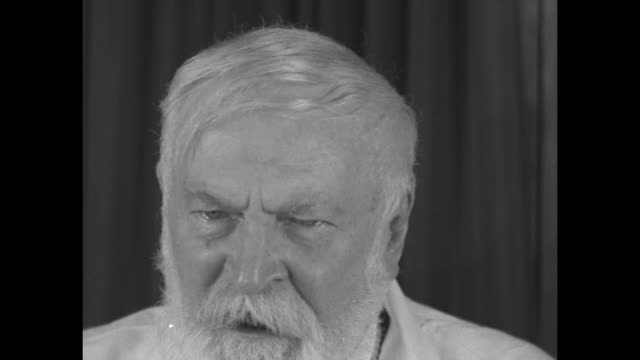 two close shots of dr. adolf lorenz sitting in chair speaking to camera, sot saying that moderation in all things is key to long life, that being... - haltbarkeit stock-videos und b-roll-filmmaterial