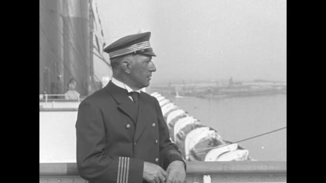 two close shots of ss ile de france captain joseph blancart posing for photo opportunity / passengers on board ship / note exact day not known - normandie stock-videos und b-roll-filmmaterial