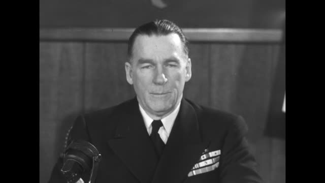 two close ups of adm william blandy sitting at desk speaking / note exact month/day not known - atomic bomb testing stock videos & royalty-free footage