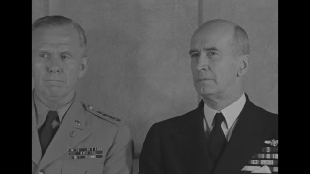 Two close ups of General George Marshall Army Chief of Staff sitting behind desk on left with Admiral Ernest King Commander in Chief of US Fleet both...