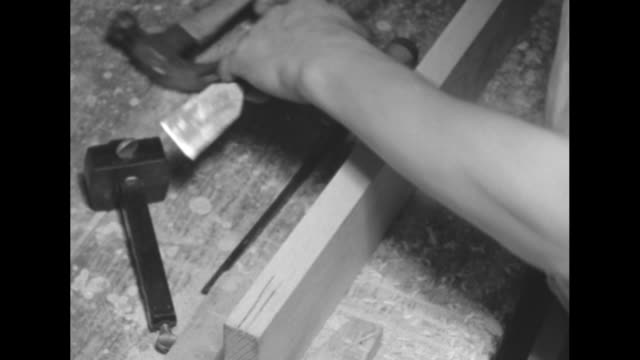 two close ups of hands working on piece of wood / cu hand using fountain pen signing mortgage dated 1936 / cu hands using machine to trim end of... - chisel stock videos and b-roll footage
