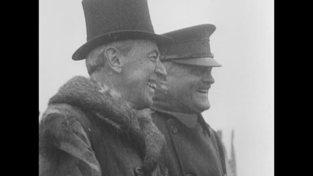 vídeos y material grabado en eventos de stock de two close ups of pres woodrow wilson and gen john pershing commander of american expeditionary forces on reviewing stand standing next to one another... - woodrow wilson