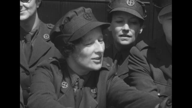 Two close ups of WRNS members / several Wrens leaning against hood of ambulance looking at map on hood with sign on roof that says 'Surgical Unit' /...
