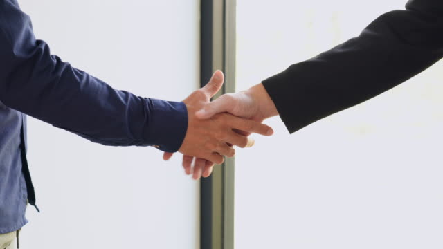 two collaboration business handshake and business people after discussing good deal of contract and new projects - ladder of success stock videos & royalty-free footage