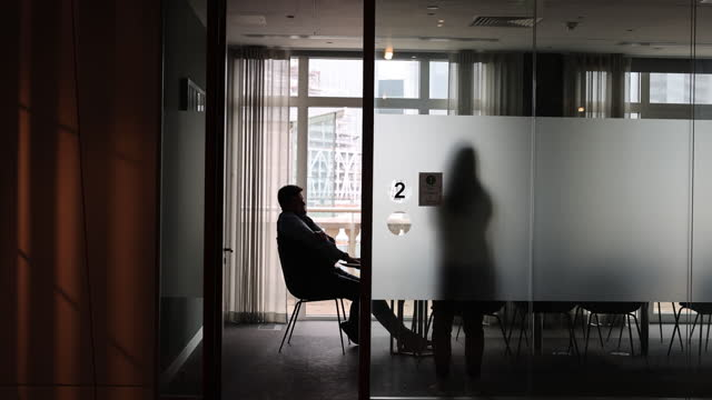 two colleagues in meeting room of singer captial markets offices in london, england, uk, on monday, august 2, 2021. - employee stock videos & royalty-free footage