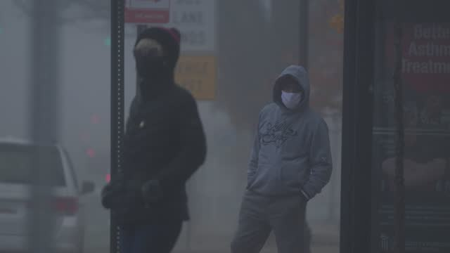two commuters waits for the bus on a foggy morning during the coronavirus pandemic on december 12, 2020 in baltimore, maryland. in maryland there are... - focus on background stock videos & royalty-free footage