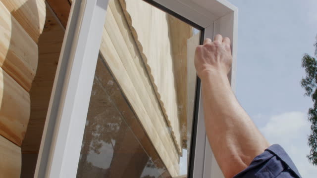 two construction workers installing window on a new house - installing stock videos & royalty-free footage