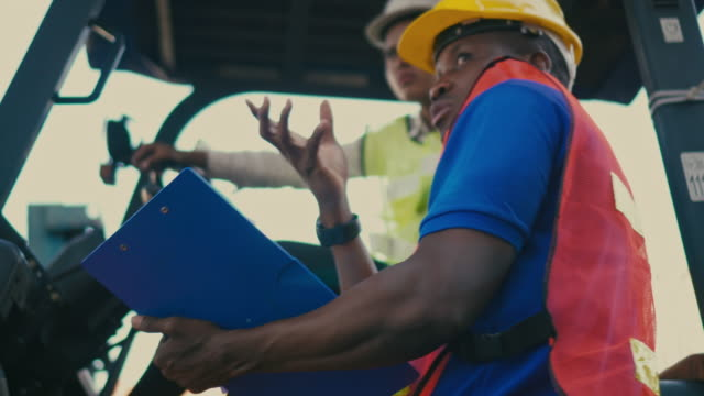 two container terminal employees working and talking in shipping port - trasporto merci via terra video stock e b–roll