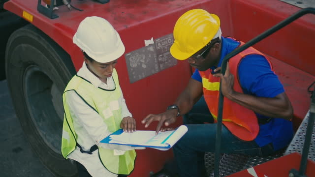 two container terminal employees working and talking in shipping port,slow motion - trasporto merci via terra video stock e b–roll
