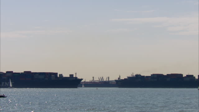 WS Two containerships passing each other / Southampton, Hampshire, United Kingdom