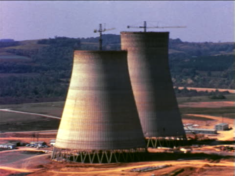 1965 two cooling towers of nuclear power plant under construction / pennsylvania / documentary - nuclear energy stock videos & royalty-free footage