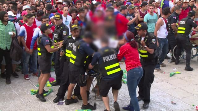 two costa rica fans were stabbed and a third wounded in the middle of a giant crowd gathered to watch the quarter final match in the countrys capital... - oranje stock videos & royalty-free footage