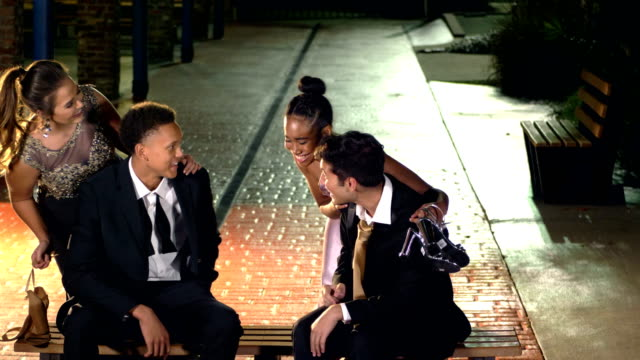 two couples after prom, hanging out outside - teenage couple stock videos & royalty-free footage