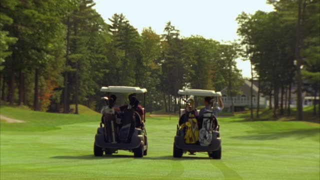 ms, ws, two couples driving in golf carts on golf course, seco, maine, usa - golf cart stock videos & royalty-free footage