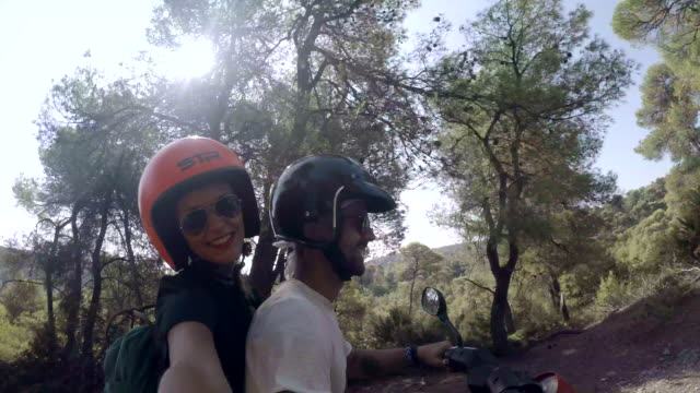 pov of two couples driving scooters motorbikes on a dirt road in skyros, greece. - scooter stock videos & royalty-free footage