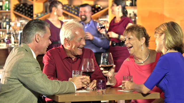 stockvideo's en b-roll-footage met twee koppels in restaurant praten en drinken - 70 79 jaar