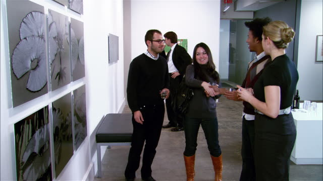 two couples introducing themselves at gallery opening - hair stubble stock videos & royalty-free footage