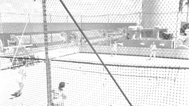 two couples play tennis on the sports deck of an ocean-liner in 1935. - 1935 stock videos & royalty-free footage