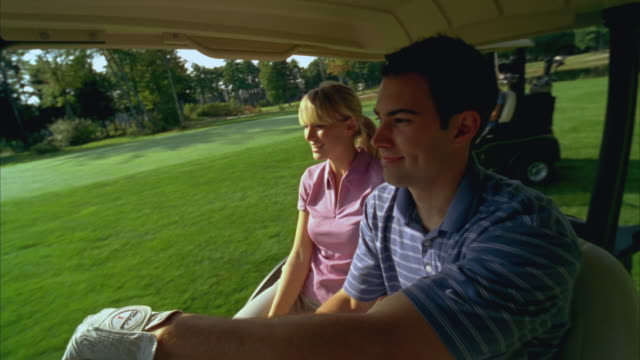 ms, two couples riding golf carts on golf course, seco, maine, usa - golf cart stock videos and b-roll footage
