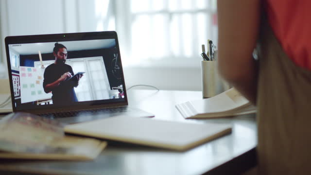 two co-workers, working from home, collaborate via videoconference from their home offices - hot desking stock videos & royalty-free footage