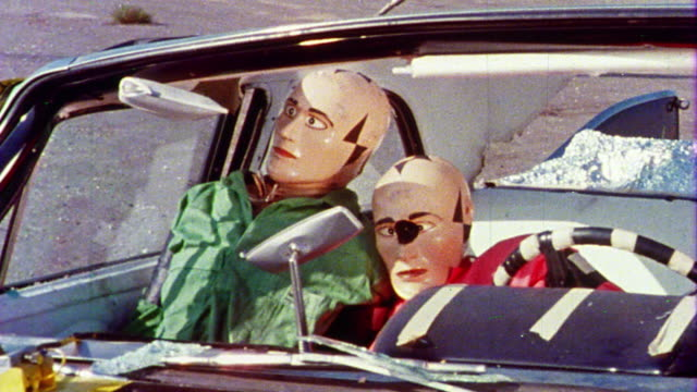 stockvideo's en b-roll-footage met 1968 ms two crash test dummies in front seat of car after test crash - auto ongeluk