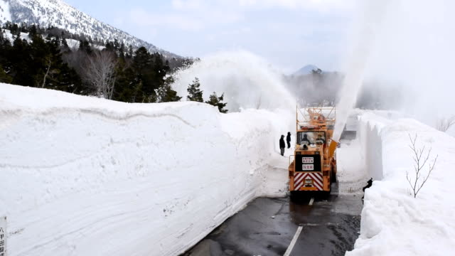 two crews working from opposite directions to dig out a snowy mountain road linked up on top of kasamatsutoge pass in aomori prefecturejapan on march... - aomori prefecture stock videos & royalty-free footage