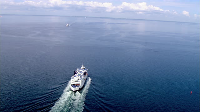 AERIAL WS Two cruise flowing on ocean  / Puttgarden, Schleswig-Holstein, Germany