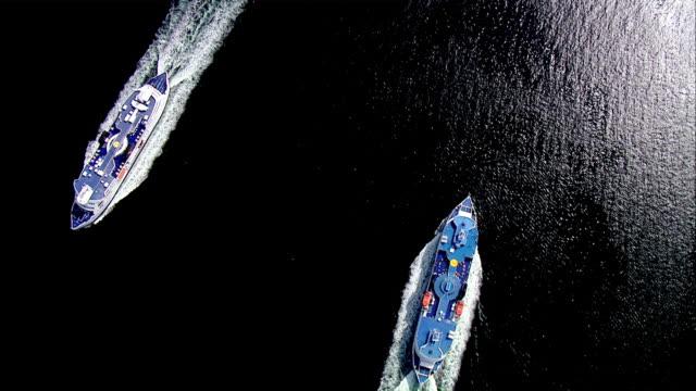 aerial ws two cruise flowing on ocean  / puttgarden, schleswig-holstein, germany - schleswig holstein stock-videos und b-roll-filmmaterial