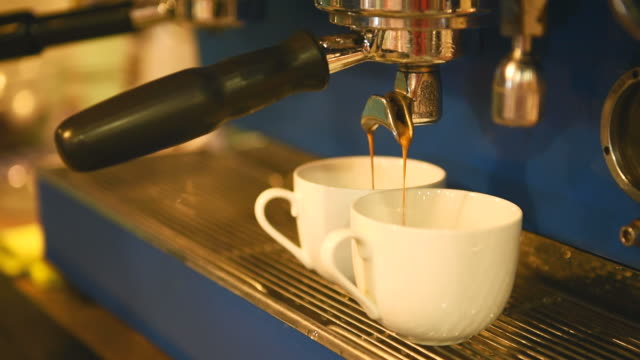 two cups filled with coffee from - cafe macchiato stock videos and b-roll footage
