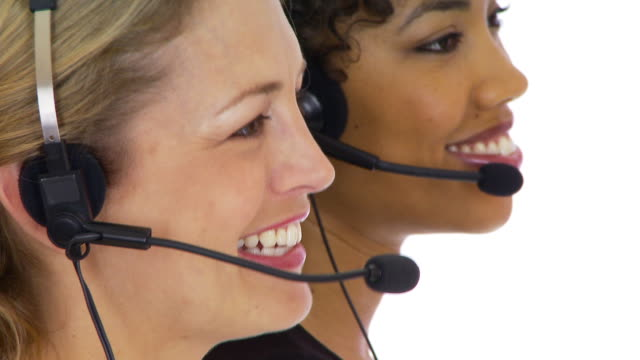two customer service women talking into headsets - weibliche angestellte stock-videos und b-roll-filmmaterial