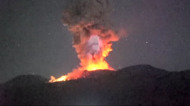 long shot redhot lava spewing into the air from the eruptive crater of mtshinmoedake and flash of lightning before 2 am / long shot redhot lava... - vulkanausbruch stock-videos und b-roll-filmmaterial