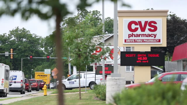 two cvs pharmacy stores in milan and rock island illinois us on tuesday august 8 2018 - cvs caremark stock videos & royalty-free footage
