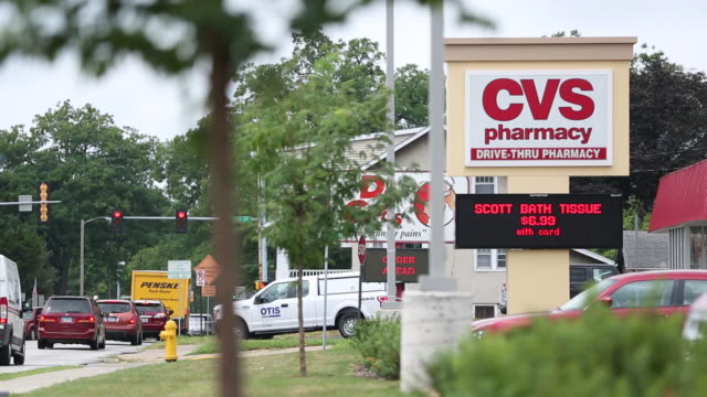 two cvs pharmacy stores in milan and rock island, illinois, us, on tuesday, august 8, 2018. - cvsケアマーク点の映像素材/bロール