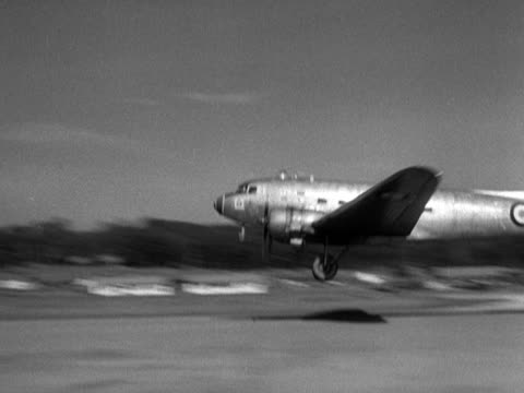 two dakota aircraft take off from an airfied in kuala lumpur. - kuala lumpur stock videos & royalty-free footage