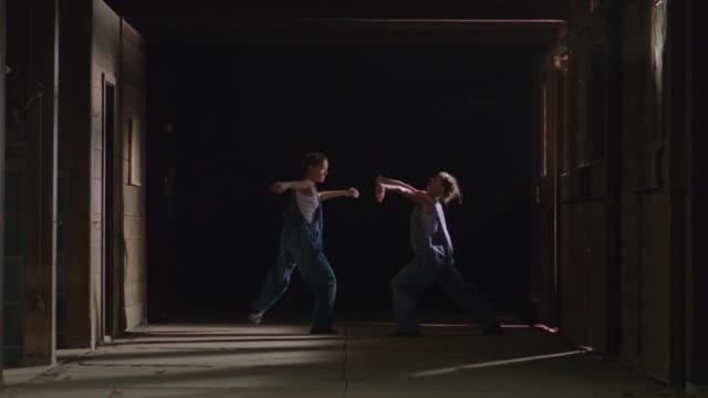 two dancers dancing together in wooden barn - アルスター郡点の映像素材/bロール