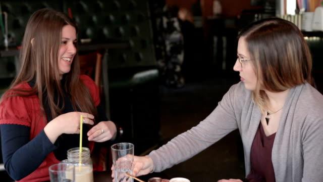 two deaf friends enjoying coffee - tecnologia assistiva video stock e b–roll