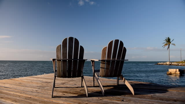 two deck chairs at sunset - outdoor chair stock videos & royalty-free footage