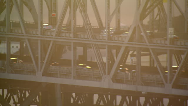 two decks of traffic comprise the bay bridge. - oakland california stock videos & royalty-free footage