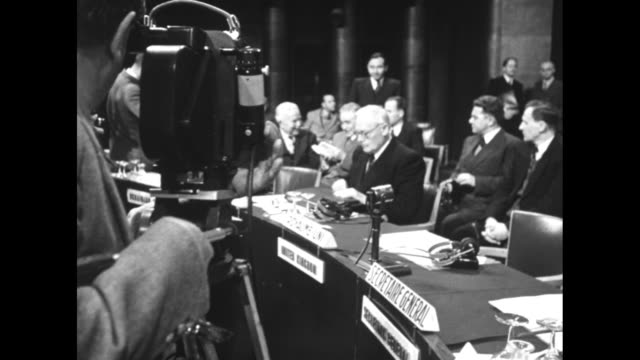 two delegates chat during a break in the session / soviet official andrey vyshinsky takes his seat / cameraman films delegates / vyshinsky / chinese... - 1948 stock videos & royalty-free footage