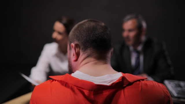 two detectives and prisoner in interrogation room - interrogation stock videos and b-roll footage