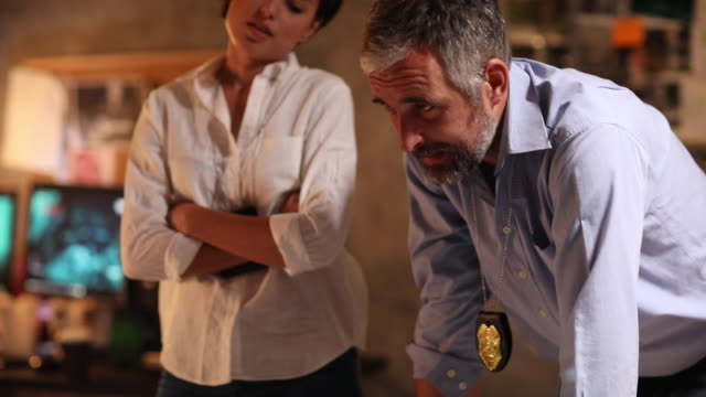 two detectives working in the station at night - suspicion stock videos & royalty-free footage