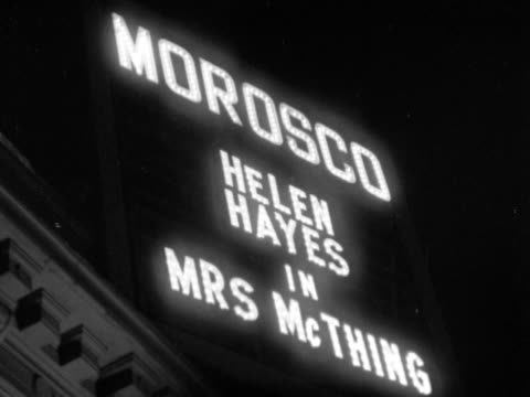 two different neon lit signs displaying actress 'helen hayes' in 'mrs mcthing' at the morosco theatre on west 45th street nyc theatre district show... - broadway manhattan video stock e b–roll