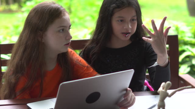 two diverse girl studying together with laptop - finger stock videos & royalty-free footage