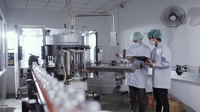two diverse male worker taking parameters in food production plant - bottling plant stock videos & royalty-free footage