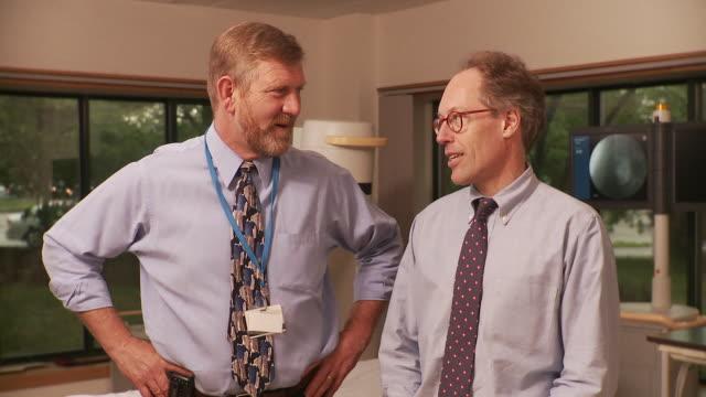 ms two doctors having discussion / south burlington, vermont, usa - burlington vermont stock videos & royalty-free footage