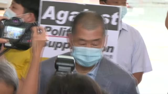 two dozen hong kong activists arrive in court for a hearing on charges over this year's tiananmen vigil. activists appearing in court include media... - dozen stock videos & royalty-free footage